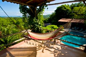 Picture hammock overlooking the pool at Rancho Armadillo Bed and Breakfast, Costa Rica Costa Rica_hotels_ resorts_ rancho armadillo_ beach_ playas del coco_ adventure inns of costa rica_costa rica airfares_costa rica car rentals_costa rica trip advisor_guanacsate_rancho armadillo_costa rica tours?costa rica surfing_costa rica fishing_costa rica volcanoes_